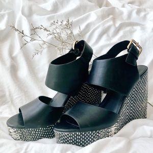 black patterned wedge sandals